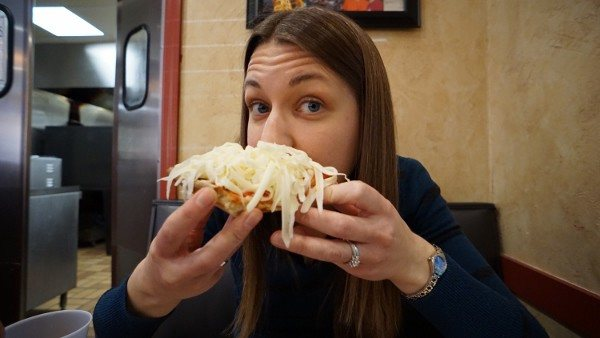 Angie trying out Beto's Pizza