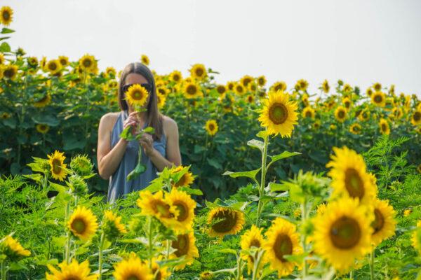 Angie enjoying her favorite flower